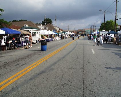 Main Street with storm clouds before Tucker Day